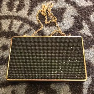 Special events clutch with removable chain